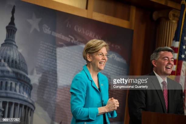 Sen Elizabeth Warren DMass and Sen Cory Gardner RColo laugh as they hold a press conference in the Senate Radio and TV Gallery to discuss bipartisan...