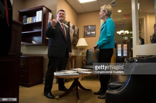 Sen Elizabeth Warren DMass and Sen Cory Gardner RColo prepare to hold a press conference in the Senate Radio and TV Gallery to discuss bipartisan...