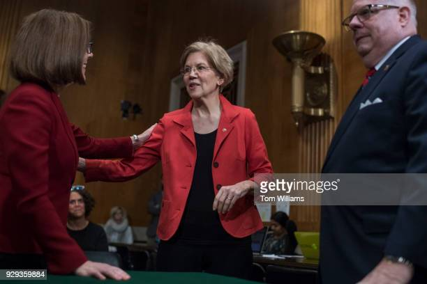 Sen Elizabeth Warren DMass center talks with Gov Kate Brown DOre and Gov Larry Hogan RMd before the governors testified at a Senate Health Education...