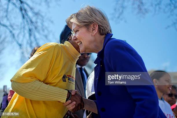 Sen. Elizabeth Warren, D-Mass., greets guests during a rally on the east lawn of the Capitol to urge Senate Minority Leader Mitch McConnell, R-Ky.,...