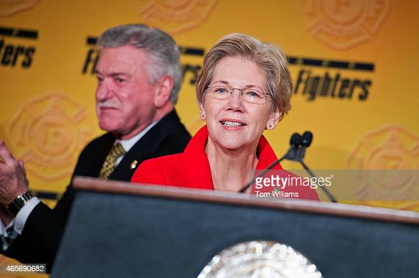 Sen Elizabeth Warren DMass prepares to speak during the International Association of Fire Fighters Legislative Conference General Session as Harold...