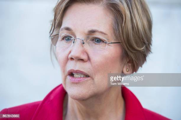 Sen Elizabeth Warren DMass talks with a reporter after a news conference on the east lawn of the Capitol on a CAP Action report saying that wealthy...