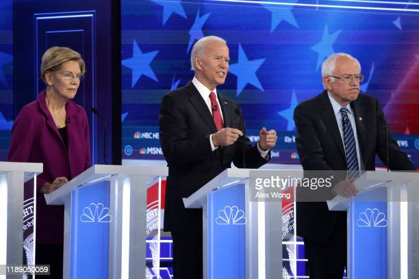 Sen Elizabeth Warren former Vice President Joe Biden and Sen Bernie Sanders participate in the Democratic Presidential Debate at Tyler Perry Studios...