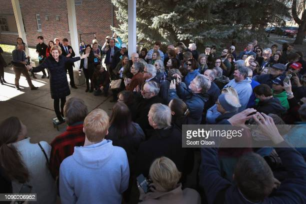 Sen Elizabeth Warren greets an overflow crowd outside of the Our Place Community Center before participating in a roundtable discussion on January 5...
