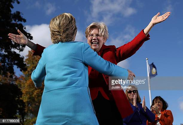 S Sen Elizabeth Warren greets democratic presidential nominee former Secretary of State Hillary Clinton during a campaign rally at Saint Anselm...