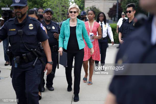 Sen. Elizabeth Warren is escorted by members of U.S. Capitol Police as she arrives at a rally in front of the U.S. Supreme Court June 9, 2021 in...
