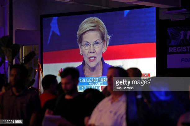 Sen Elizabeth Warren is seen on a television at a watch party for the first Democratic presidential primary debates for the 2020 elections in Miami...