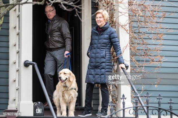 Sen. Elizabeth Warren , leaves her home with her husband Bruce Mann and dog Bailey to address the media after announcing she formed an exploratory...
