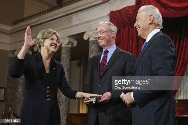 S Sen Elizabeth Warren participates in a reenacted swearingin with her husband Bruce Mann and US Vice President Joe Biden in the Old Senate Chamber...