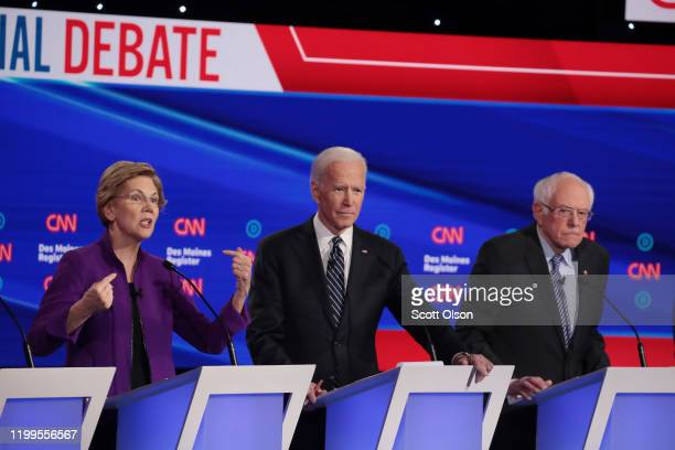 Sen Elizabeth Warren speaks as former Vice President Joe Biden and Sen Bernie Sanders listen during the Democratic presidential primary debate at...