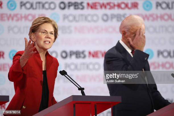 Sen Elizabeth Warren speaks as former Vice President Joe Biden listens during the Democratic presidential primary debate at Loyola Marymount...