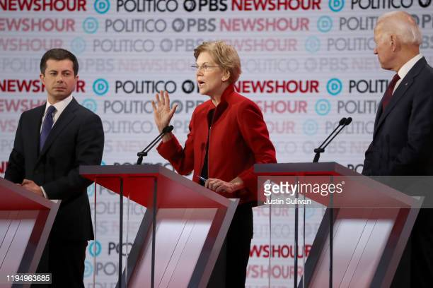 Sen Elizabeth Warren speaks as South Bend Indiana Mayor Pete Buttigieg and former Vice President Joe Biden listen during the Democratic presidential...