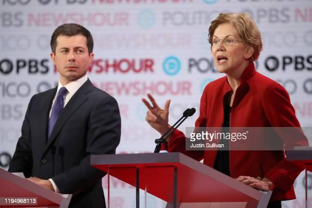 Sen Elizabeth Warren speaks as South Bend Indiana Mayor Pete Buttigieg listens during the Democratic presidential primary debate at Loyola Marymount...