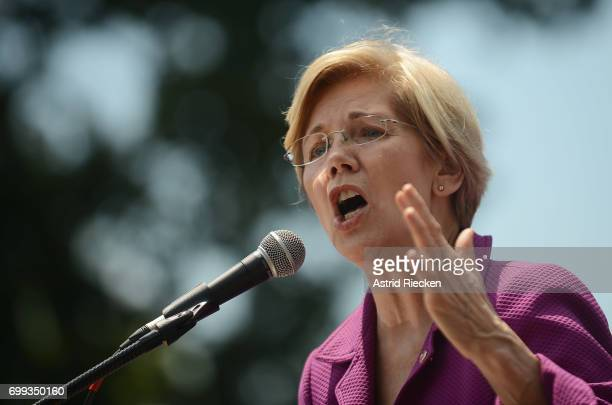 Sen. Elizabeth Warren speaks at a rally to oppose the repeal of the Affordable Care Act and its replacement on Capitol Hill on June 21, 2017 in...