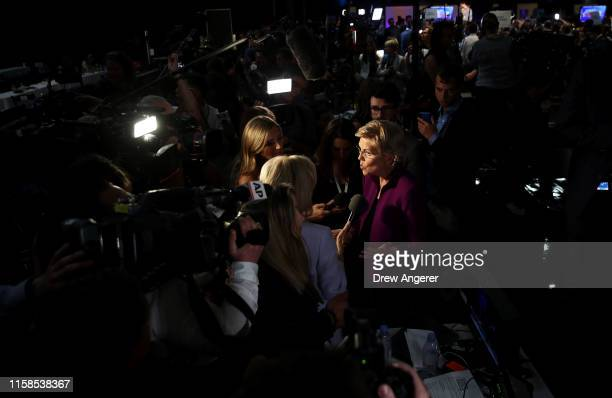 Sen Elizabeth Warren speaks to the media in the spin room after the first night of the Democratic presidential debate on June 26 2019 in Miami...