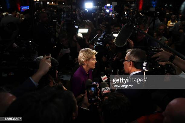 Sen Elizabeth Warren speaks to the media in the spin room following the first night of the Democratic presidential debate on June 26 2019 in Miami...