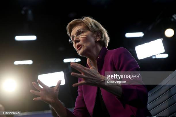 Sen. Elizabeth Warren speaks to the media in the spin room following the first night of the Democratic presidential debate on June 26, 2019 in Miami,...