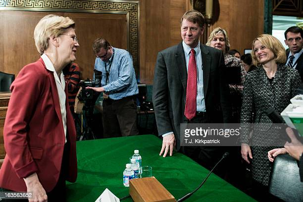 S Sen Elizabeth Warren speakswith Richard Cordray center nominee for director of the Consumer Financial Protection Bureau and his wife Peggy Cordray...