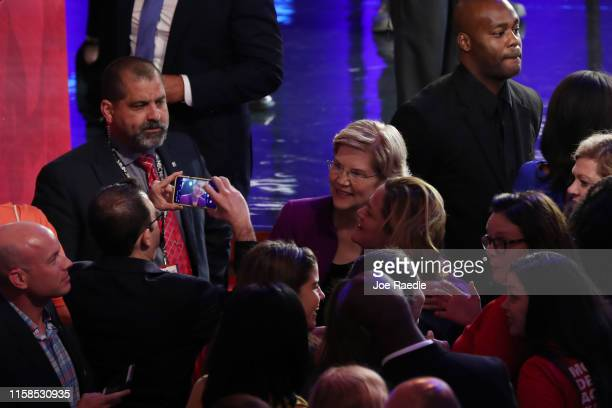 Sen Elizabeth Warren takes a photo with audience member after the first night of the Democratic presidential debate on June 26 2019 in Miami Florida...