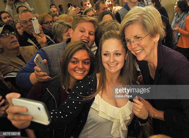 S Sen Elizabeth Warren takes time out for a quick photo with Lailey Barbour Caroline Closson and Riley Willman during a campaign rally for US Rep...