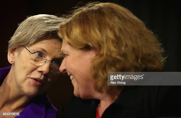 S Sen Elizabeth Warren talks to Sen Heidi Heitkamp during a hearing before the Senate Banking Housing and Urban Affairs Committee February 24 2015 on...
