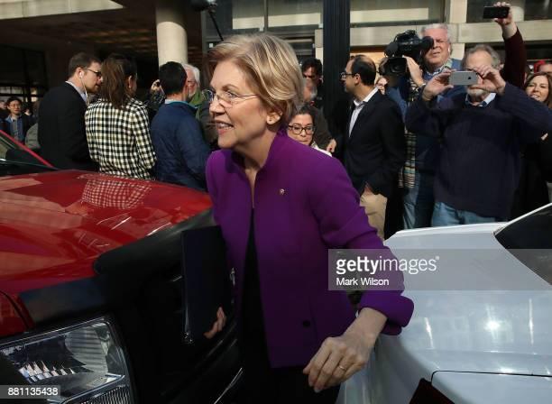 Sen Elizabeth Warren walks away after speaking in front of the Consumer Financial Protection Bureau headquarters on November 28 2017 in Washington DC...