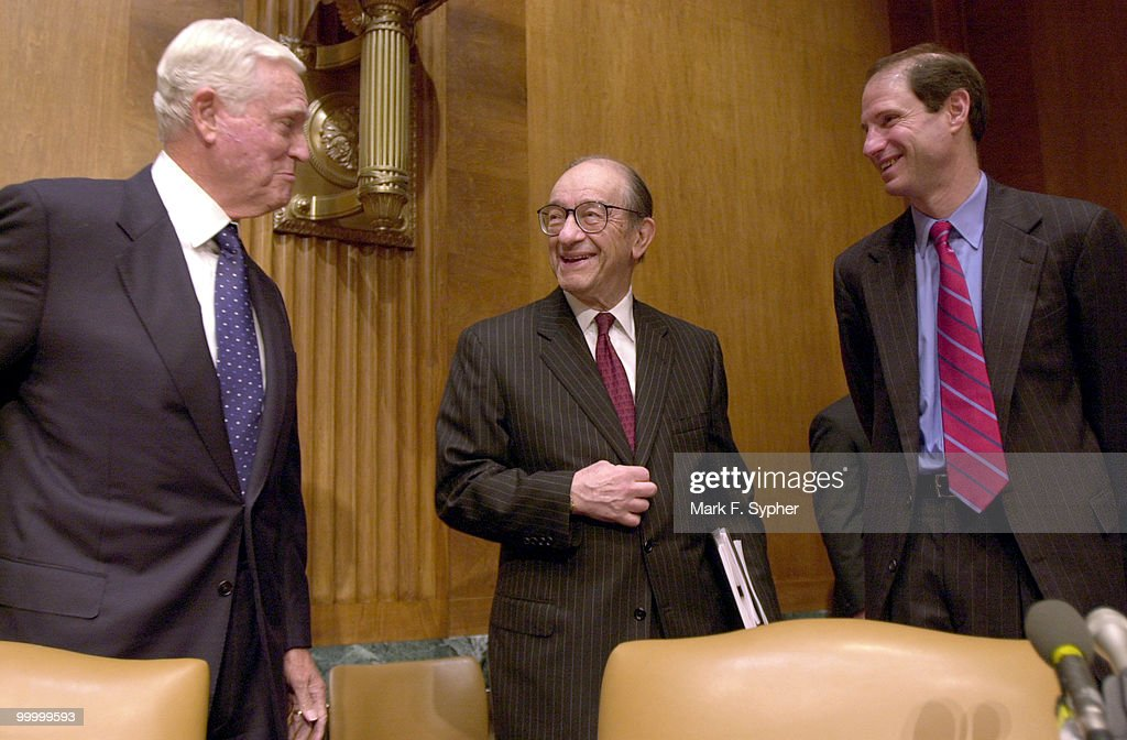 Sen. Ernest F. Hollings (D-SC), left, and Sen. Ron Wyden (D-OR), right, greet chairman of the Board of Govenors, Federal Reserve System, Alan Greenspan, during Greenspan's 18th appearance before the Senate's Budget Committee on Thursday.