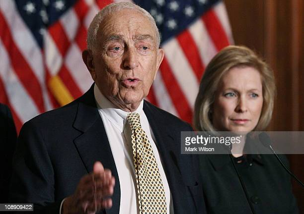 S Sen Frank Lautenberg speaks while US US Sen Kristen Gillibrand listens during a news conference to discuss women's health issues at the US Capitol...
