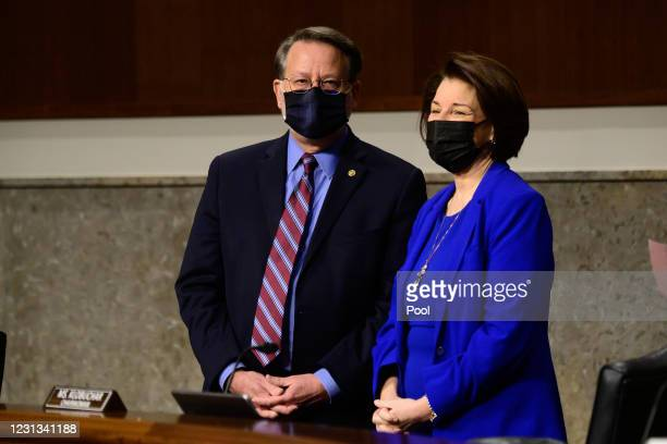 Sen. Gary Peters and Sen. Amy Klobuchar speak before the start of a Senate Homeland Security and Governmental Affairs and Senate Rules and...
