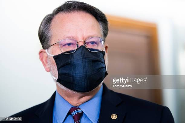 Sen. Gary Peters, D-Mich., chairman of the Senate Homeland Security and Governmental Affairs Committee, arrives for a joint hearing with the Senate...