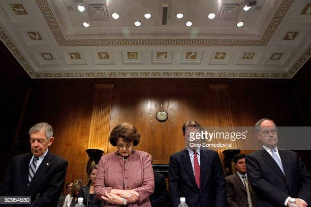 Sen George Voinovich Sen Dianne Feinstein Sen Evan Bayh and Rep Jim Cooper observe a moment of silence for the victims of last weeks mass shooting at...