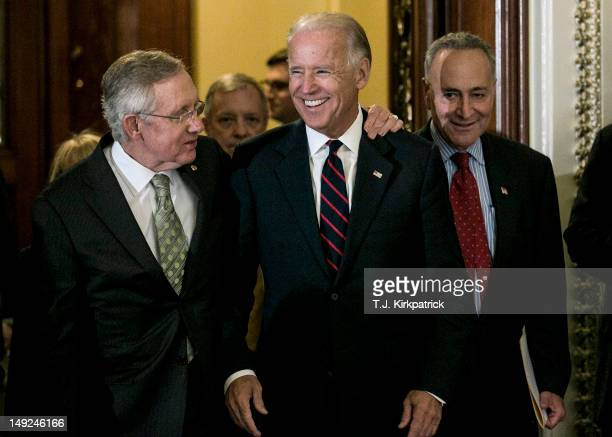 S Sen Harry Reid and US Sen Charles Schumer leave the Senate chambers with US Vice President Joe Biden to speak at a press conference following a...