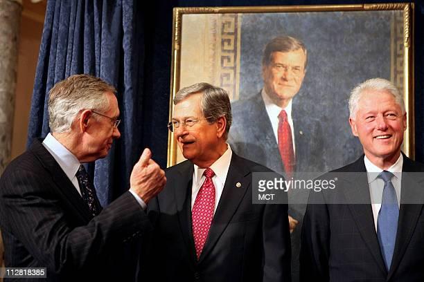 Sen Harry Reid left and former President Bill Clinton right joined former Senate Majority leader Trent Lott whose portrait was unveiled as part of...