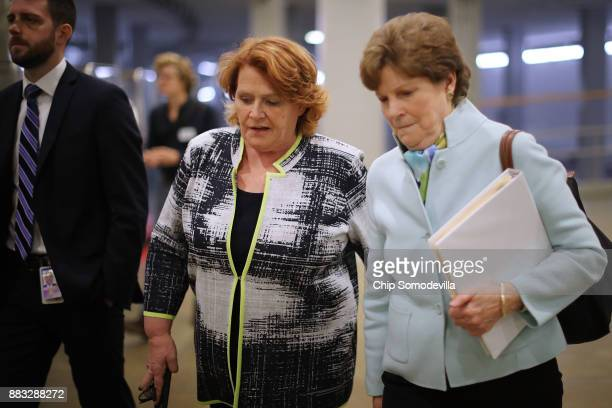 Sen Heidi Heitkamp and Sen Jeanne Shaheen head for a vote in the basement of the US Capitol November 30 2017 in Washington DC The Senate is debating...