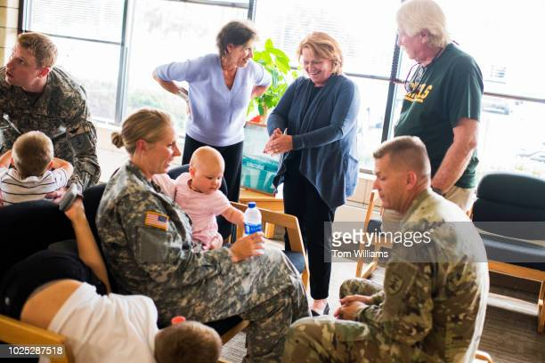 Sen Heidi Heitkamp DND talks with National Guardsmen in Bismarck ND on August 17 before some troops were deployed to Africa Heidi Heitkamp is running...