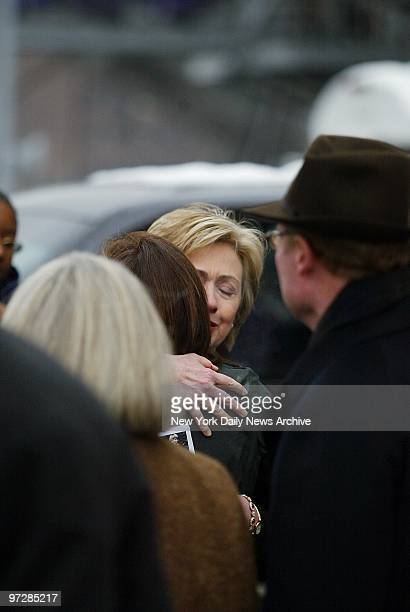 Sen Hillary Clinton comforts family members at a funeral service for Anthony and Anne Fisher aboard the Intrepid SeaAirSpace Museum Fisher a...