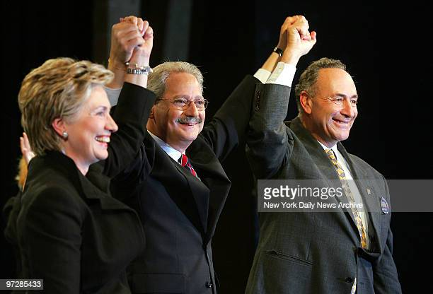 Sen Hillary Clinton Democratic mayoral candidate Fernando Ferrer and Sen Chuck Schumer raise their hands in unity during a rally at LaGuardia...