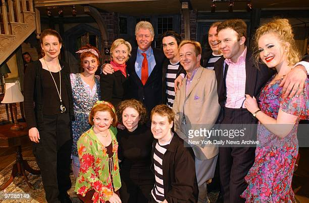 Sen Hillary Clinton former President Bill Clinton and daughter Chelsea join cast members of the Broadway show Noises Off after their performance at...