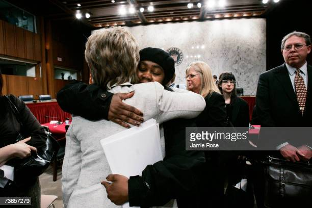 Sen. Hillary Clinton hugs a tearful 9/11 survivor Cynthia Shepherd of Brooklyn, New York after a hearing before the Senate Committee on Health,...