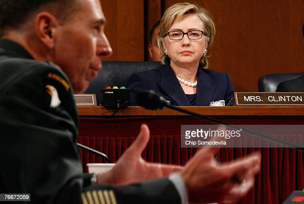 Sen Hillary Clinton listens as General David Petraeus testifies before the Senate Armed Services Committee on Capitol Hill September 11 2007 in...