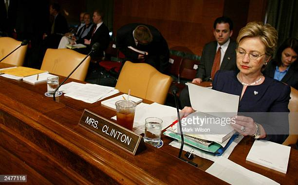 S Sen Hillary Clinton looks over her papers before the start of a Senate Armed Services Committee hearing on Capitol Hill September 9 2003 in...