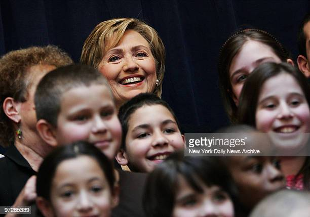 Sen Hillary Clinton stands among children during a news conference at the Ryan ChelseaClinton Community Heath Center on 10th Ave where she was...