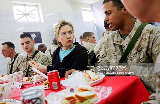 Sen Hillary Clinton talks with Marines from New York at her table Lance Cpl Ilya Kaufman of Brooklyn Lance Cpl Kevin Kerbis of Staten Island and...