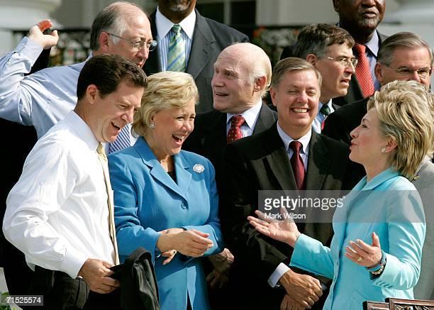 S Sen Hillary Clinton talks with Sen Lindsey Graham Sen Mary Landrieu and Sen Sam Brownback before President Bush signed the Fannie Lou Hamer Rosa...