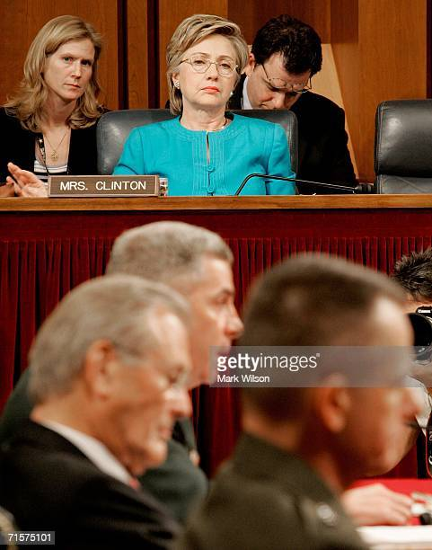 S Sen Hillary Clinton watches as Secretary of Defense Donald Rumsfeld General John Abizaid and Chairman of the Joint Chiefs of Staff Gen Peter Pace...