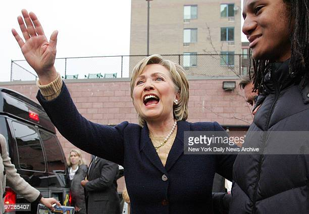 Sen Hillary Clinton waves to supporters on W 45th St as she leaves the Ryan ChelseaClinton Community Heath Center where she held a news conference...
