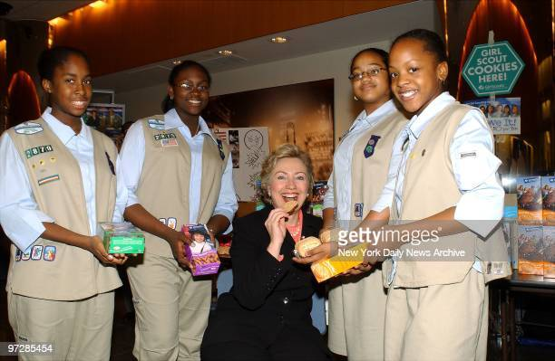 Sen Hillary Clinton who was the honorary president of the Girl Scouts when she was First Lady samples a cookie from Brooklyn Troop 2879 members Rhoya...