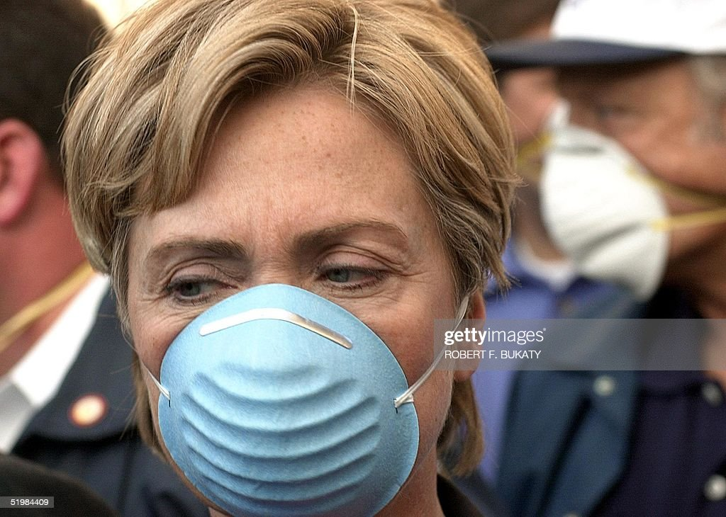 Sen. Hillary Rodham Clinton, Democrat of New York, wears a dust mask while touring the site of the World Trade Center 12 September, 2001, one day after a terrorist attack destroyed the twin towers of the center.