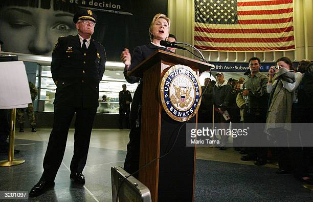 Sen Hillary Rodham Clinton speaks as Amtrak Police Chief of Patrol and Special Operations John O'Connor looks on at a media conference about rail...