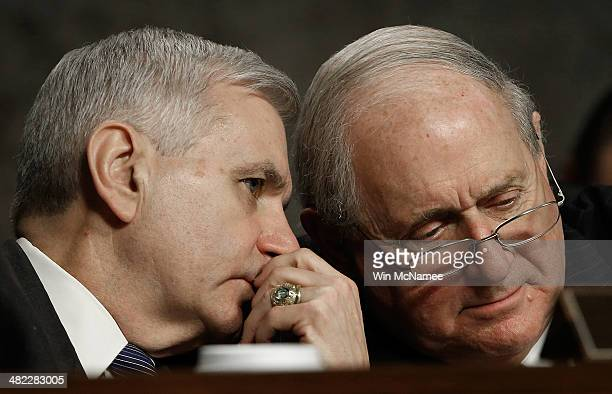 Sen Jack Reed and Committee Chairman Sen Carl Levin confer as Chief of Staff of the Army Gen Raymond Odierno appears before the Senate Armed Services...
